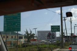 Factory road and billboards in Antigua.jpg