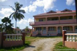Pink 2 story house in Antigua.jpg