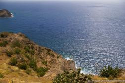 Shirley Heights cliff and ocean in Antigua.jpg