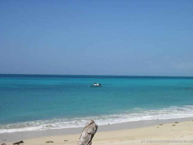 Small boat in the waters off a beach in Antigua.jpg