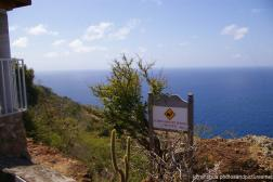 Sudden Drop Off Beyond This Point warning sign at Shirley Heights Antigua.jpg