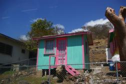 Tiny turquoise and pink house in Antigua.jpg