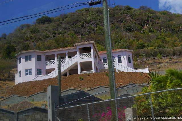 Two story light pink home in Antigua.jpg