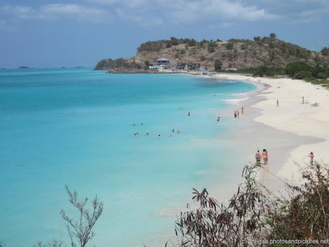 Vacationers at a nice beach in Antigua.jpg