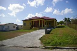 Yellow house with red roof in Antigua.jpg