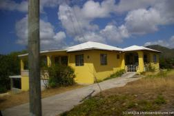 Yellow house with white roof in Antigua.jpg