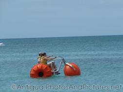 Two people on a Water Trike at Dickenson Beach in Antigua.jpg