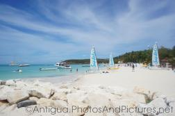 Several Sandals sail boats at Dickenson Beach Antigua.jpg