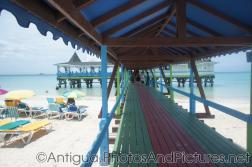Looking down th epier of Warri Pier Restaurant at Dickenson Beach Antigua.jpg