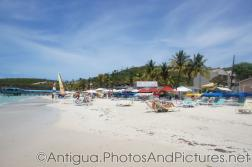 JHR Grand Estates sign and beach chairs at Dickenson Beach Antigua.jpg